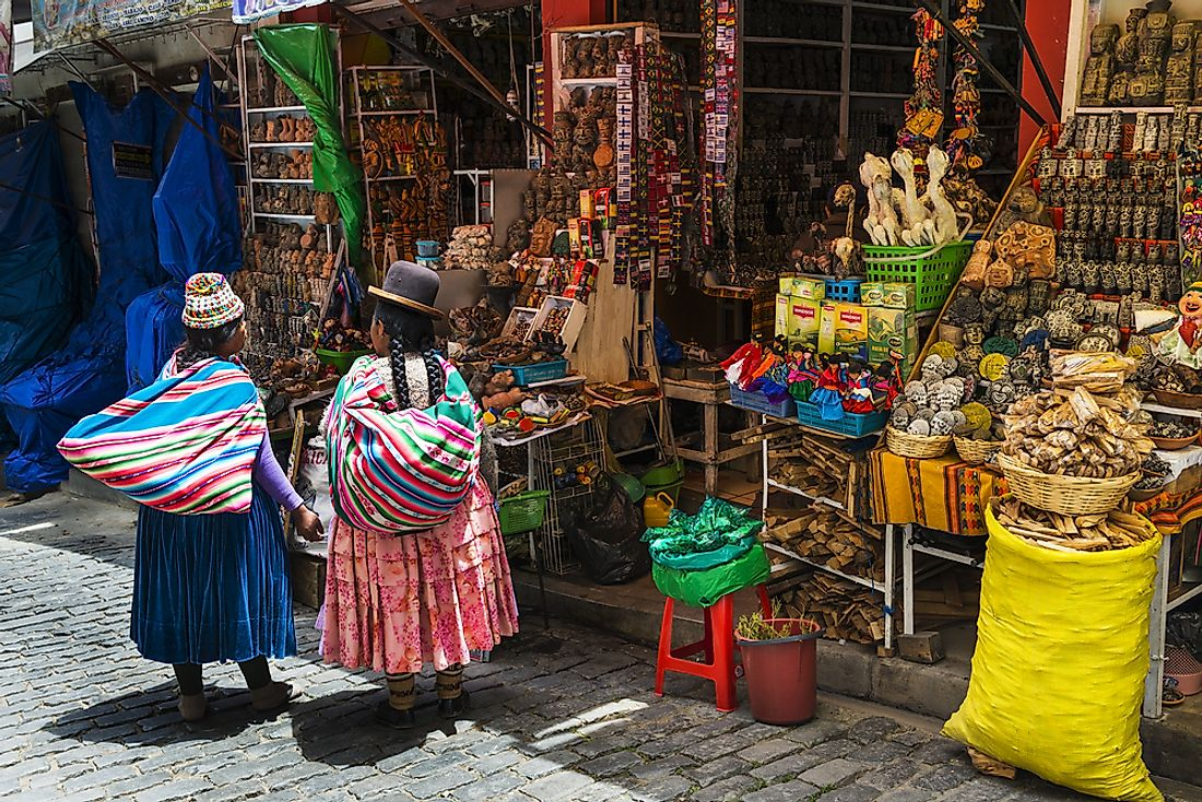Indigenous Bolivian women shopping in La Paz, Bolivia. Editorial credit: Peek Creative Collective / Shutterstock.com