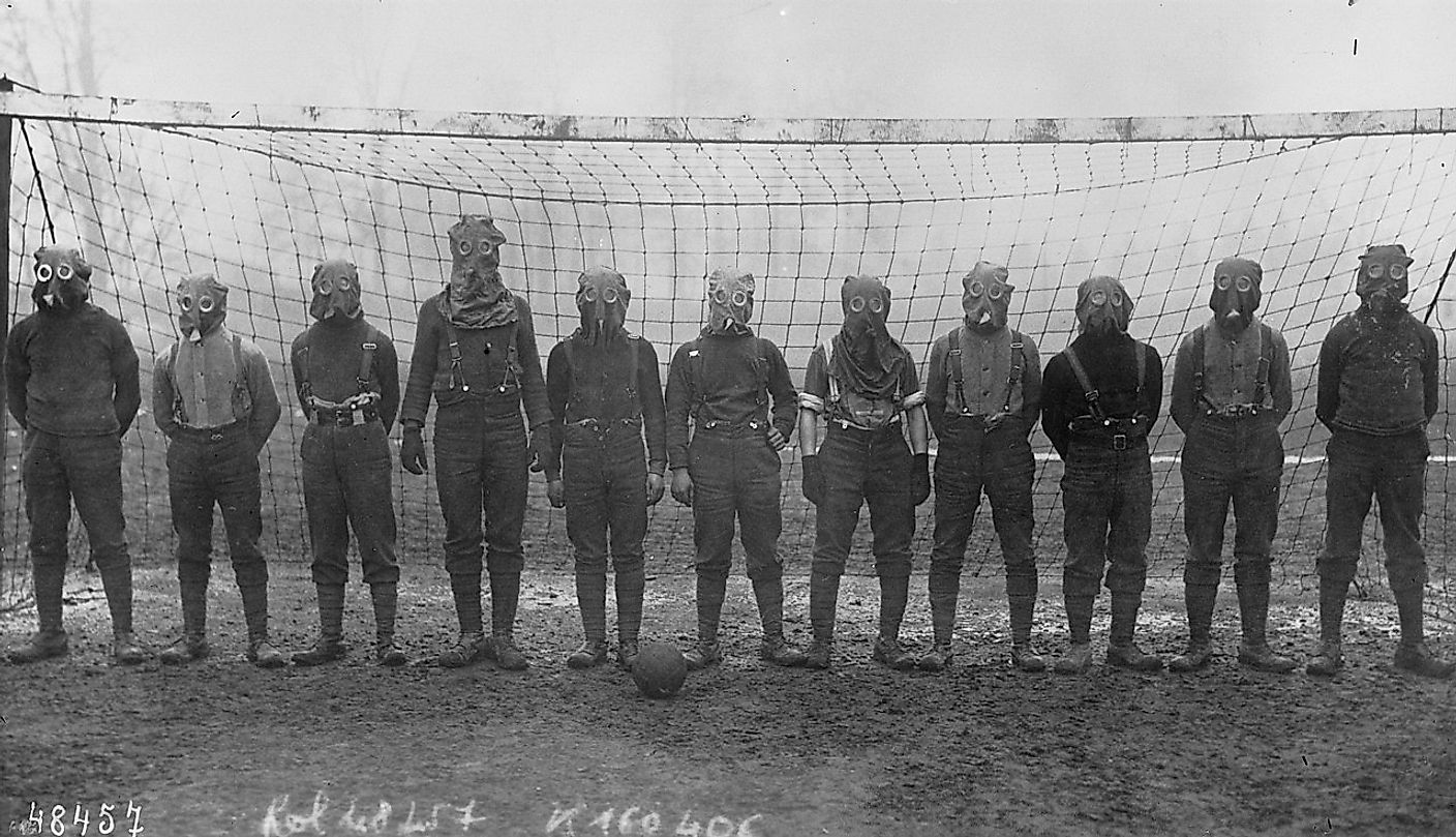Football team of British soldiers with gas masks, Western front, 1916. Image credit: Agence Rol/Public domain