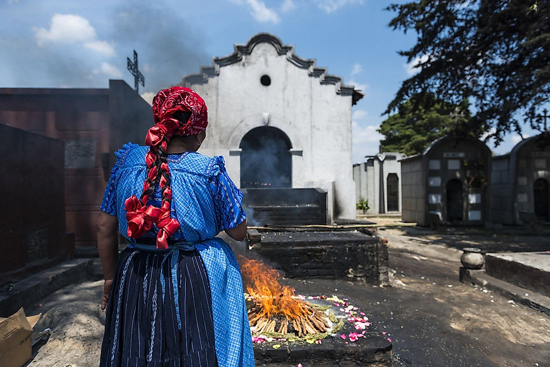 A woman performs a traditional Mayan ceremony in Guatemala. Editorial credit: Peek Creative Collective / Shutterstock.com.