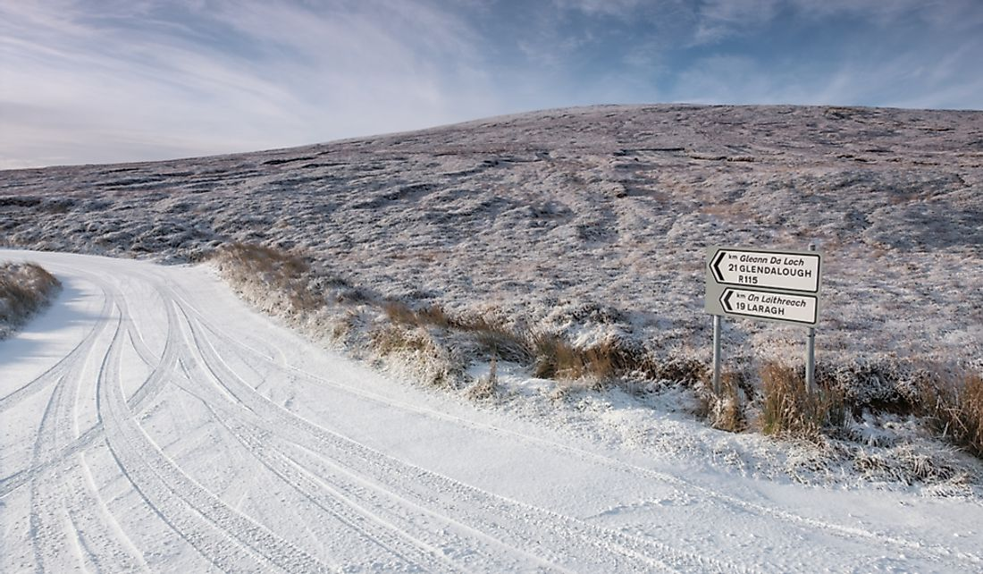 Snow covered road in Wicklow Mountains National Park in Laragh, County Wicklow, Ireland.
