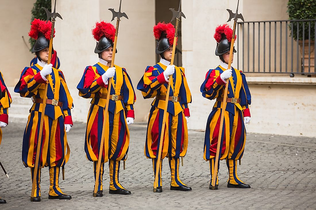 The Papal Swiss Guard in Vatican City.  Editorial credit: Drop of Light / Shutterstock.com.