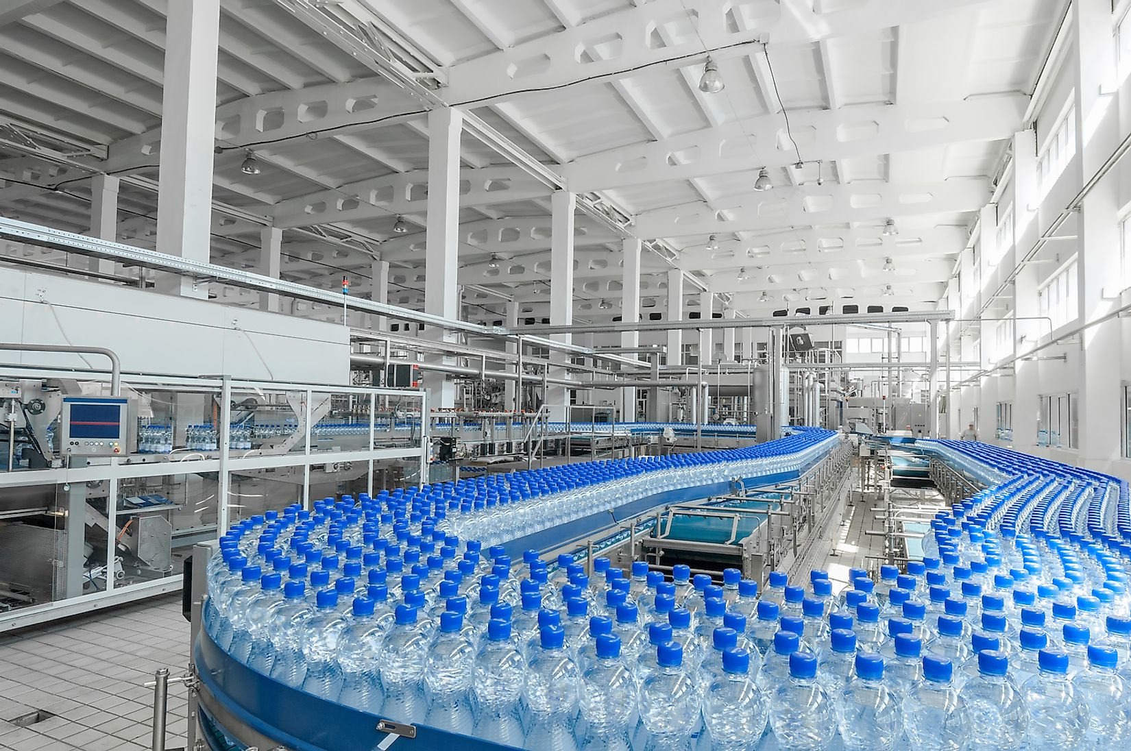 Plastic bottle manufacturing in a factory. Image credit: Alba_alioth/Shutterstock.com