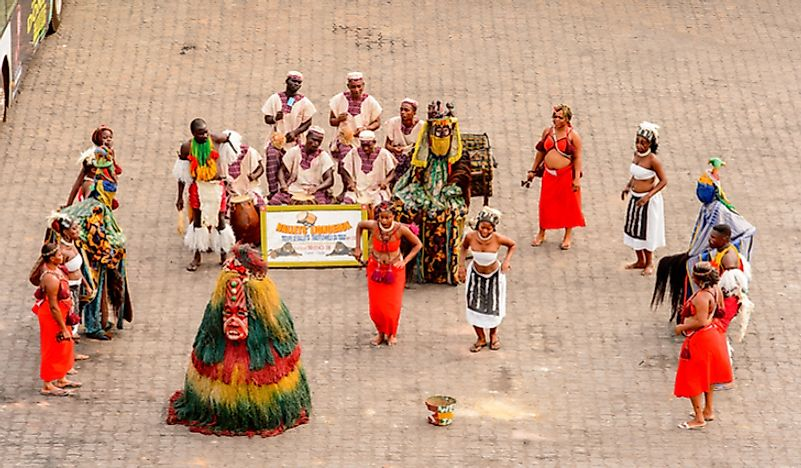 Togolese people perform a dance in traditional costumes in Lomé, Togo. Editorial credit: Anton_Ivanov / Shutterstock.com.