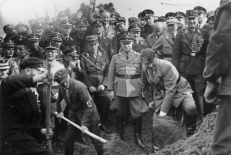 Adolf Hitler taking part in a groundbreaking ceremony for a public works project in 1930s Fascist Germany.