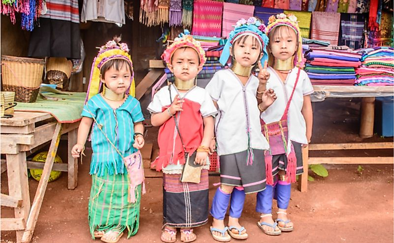 Younger Kayan women wear the neck coils primarily to cater to the tourist industry. Editorial credit: Aung Myat / Shutterstock.com
