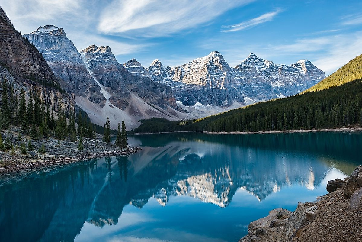 Stunning lakeside view of the Ten Peaks and their reflections off of the water on Moraine Lake.