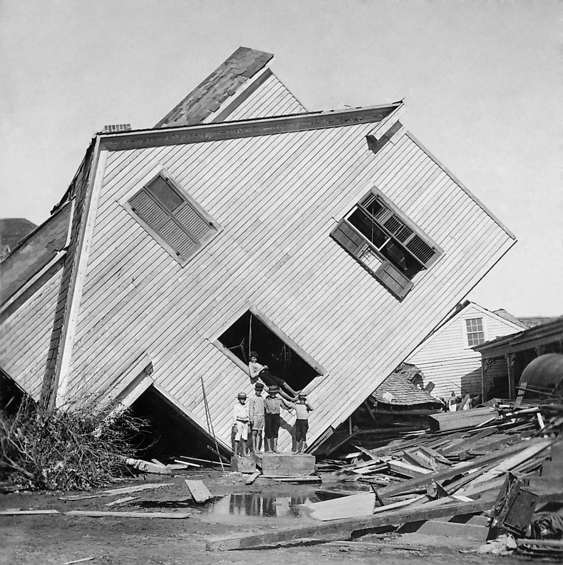 A house turned on its side from the force of the disastrous Galveston Hurricane in 1900. Editorial credit: Everett Historical / Shutterstock.com.