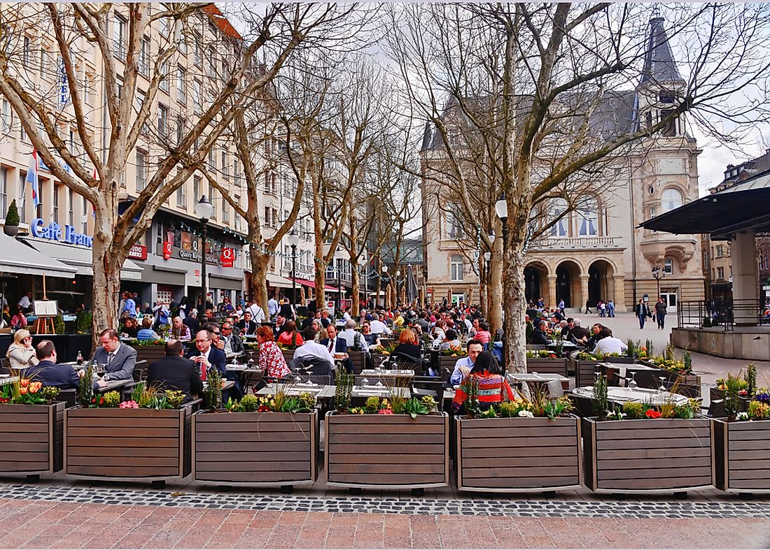 People sit in Luxembourg City, Luxembourg. Editorial credit: elvisvaughn / Shutterstock.com.