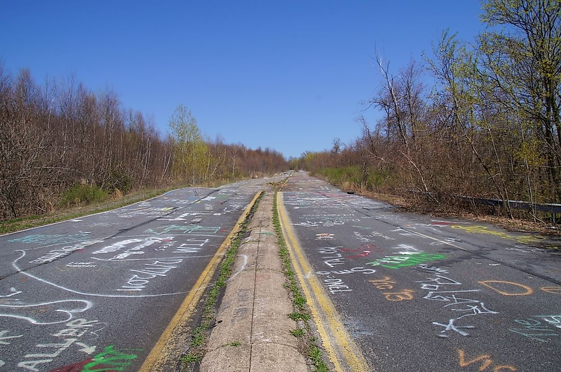 An abandoned road in Centralia, Pennsylvania that has been covered in chalk graffiti.