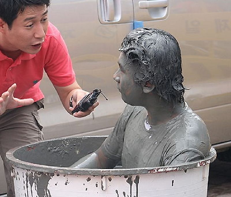 A man takes a mud bath during the 2008 edition of the Boryeong Mud Festival.