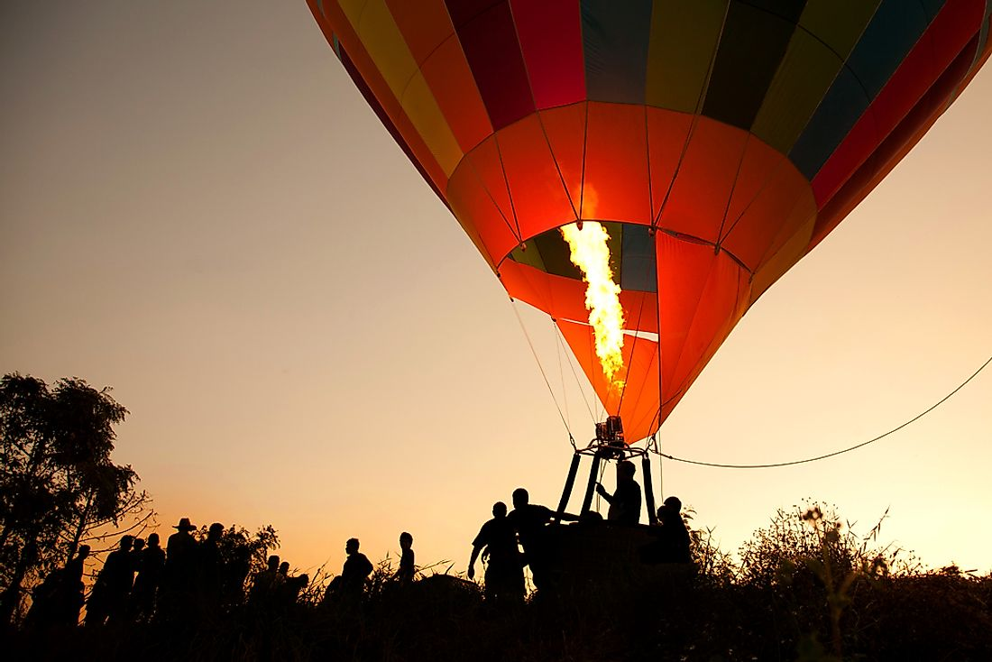 Hot air balloons are kept afloat by burning gasses.