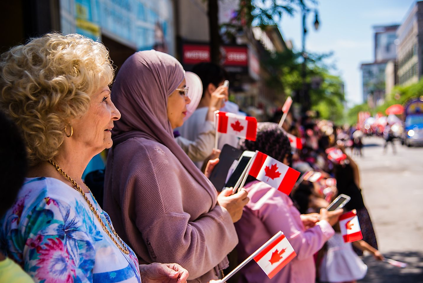 Canadians watching the Canada Day Parade. Image credit:  Vincent JIANG/Shutterstock.com