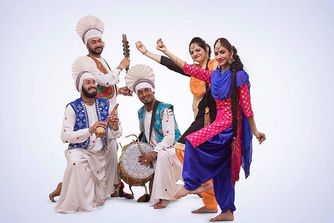A Bhangra dance ensemble from India with their accompanying musicians.