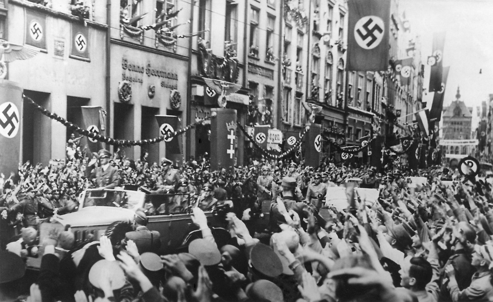 Danzig (Gdansk) greets the Fuhrer on Sept. 19, 1939. German Chancellor, Adolf Hitler receives Nazi Salutes as his rides in victory through Danzig. Image source: Everett Collection/Shutterstock.com