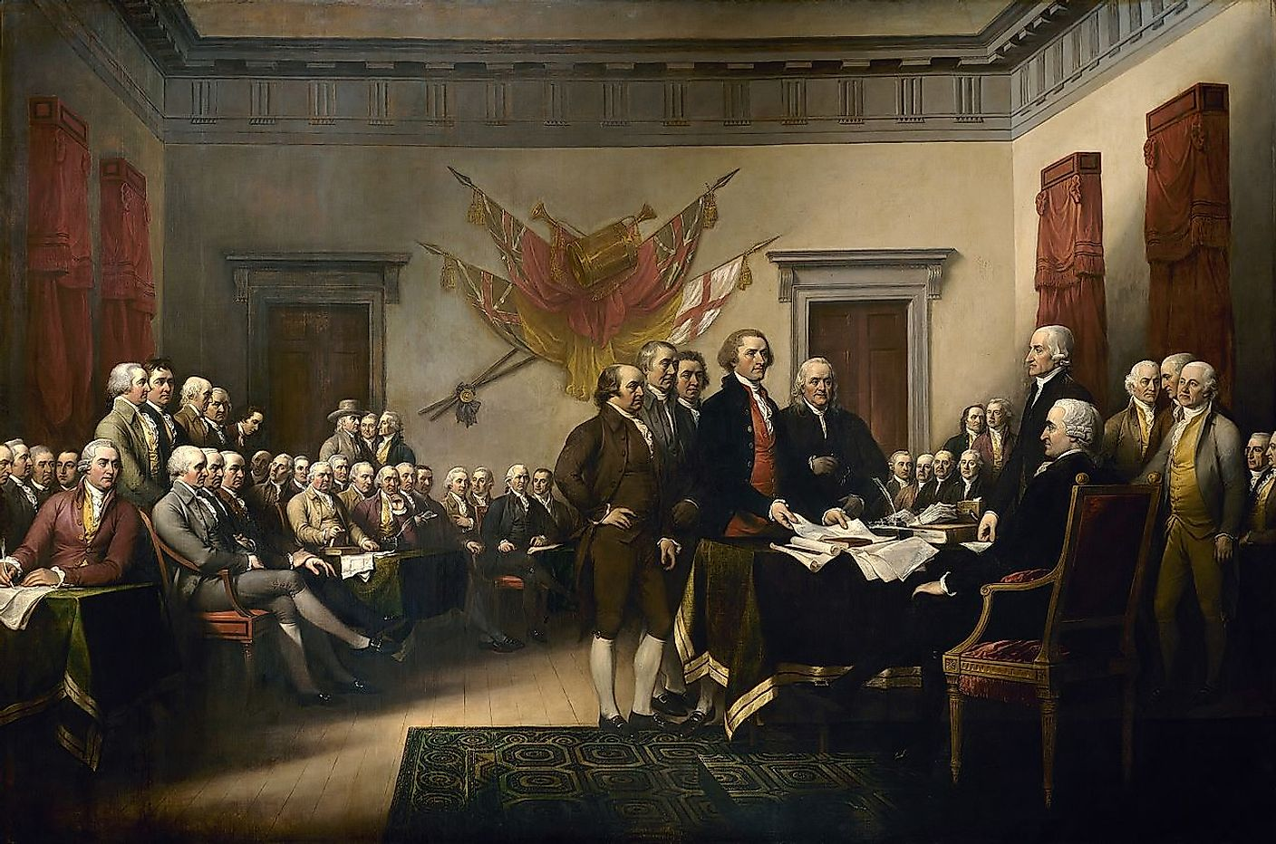 John Adams is at the centre with hand on his hip while the committee presents the declaration of independence to congress