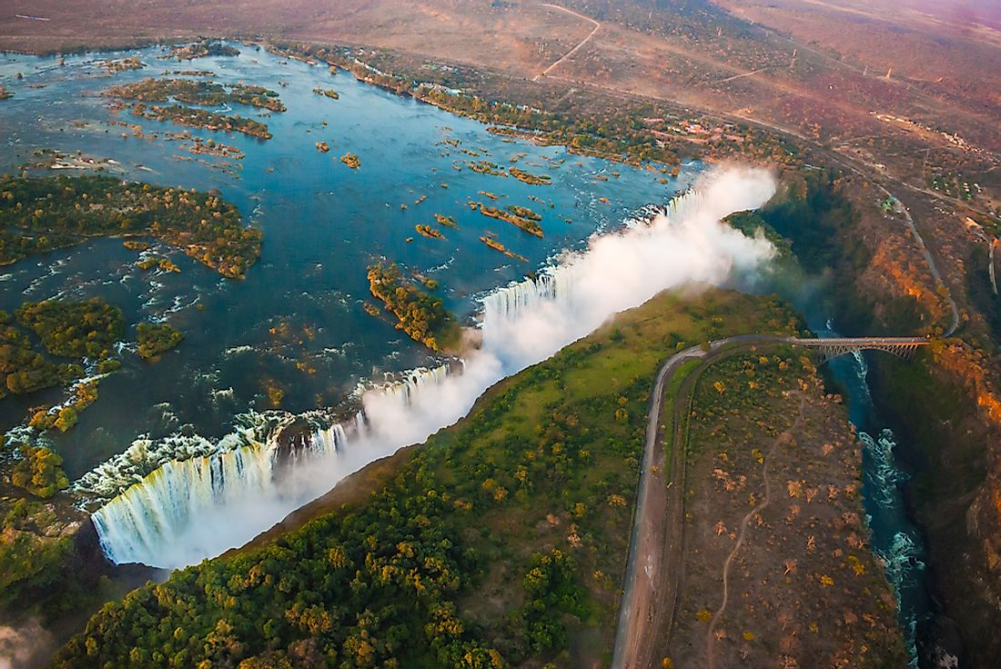 Sun sets upon the Victoria Falls along the Zambia-Zimbabwe border.