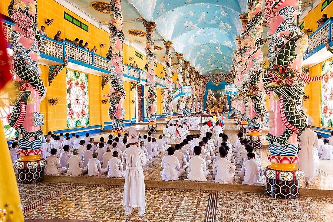 Beautiful interior of the central home and Holy See of the Cao Dai faith in Tay Ninh, Vietnam. Editorial credit: R.M. Nunes / Shutterstock.com.