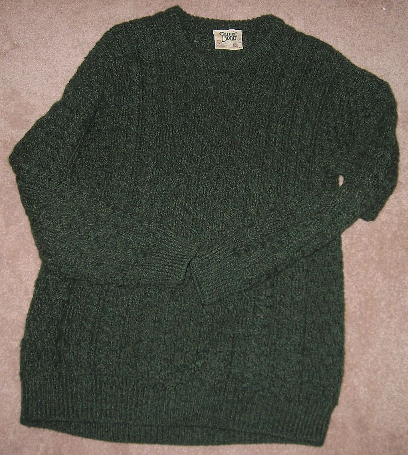 "Aran Sweater, green, made by ""Carraig Donn"", Ireland. Image credit: User:Smee/Public domain"