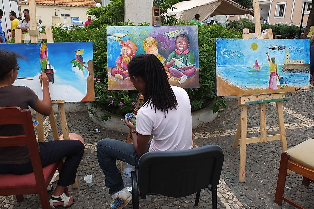 Cape Verdean artists painting in the streets of Praia. Editorial credit: Alain Lauga / Shutterstock.com.