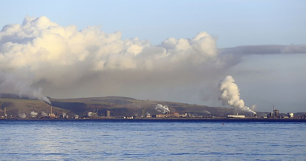 Plumes of smoke rise from coal-fired steel mills in Port Talbot, Wales, United Kingdom.