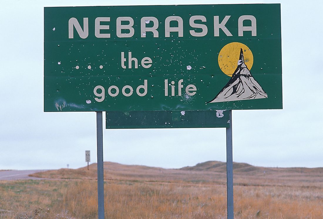 A state sign welcoming visitors to Nebraska.
