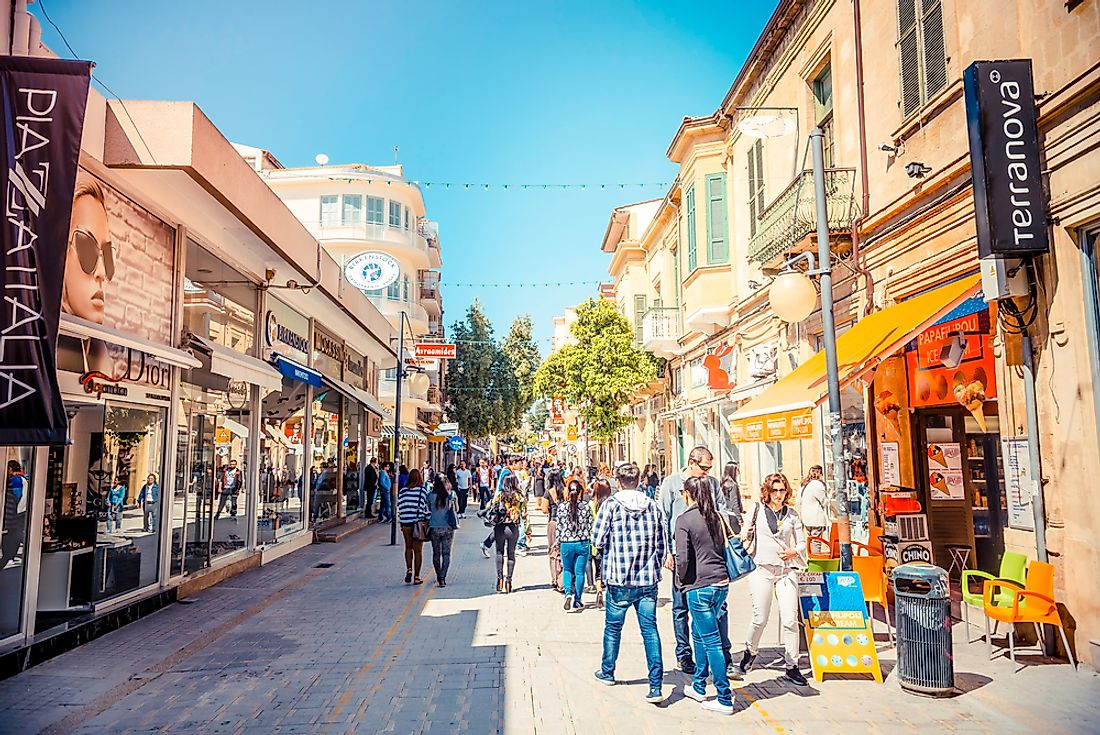People walk down the street in Nicosia, Cyprus. Editorial credit: kirill_makarov / Shutterstock.com.