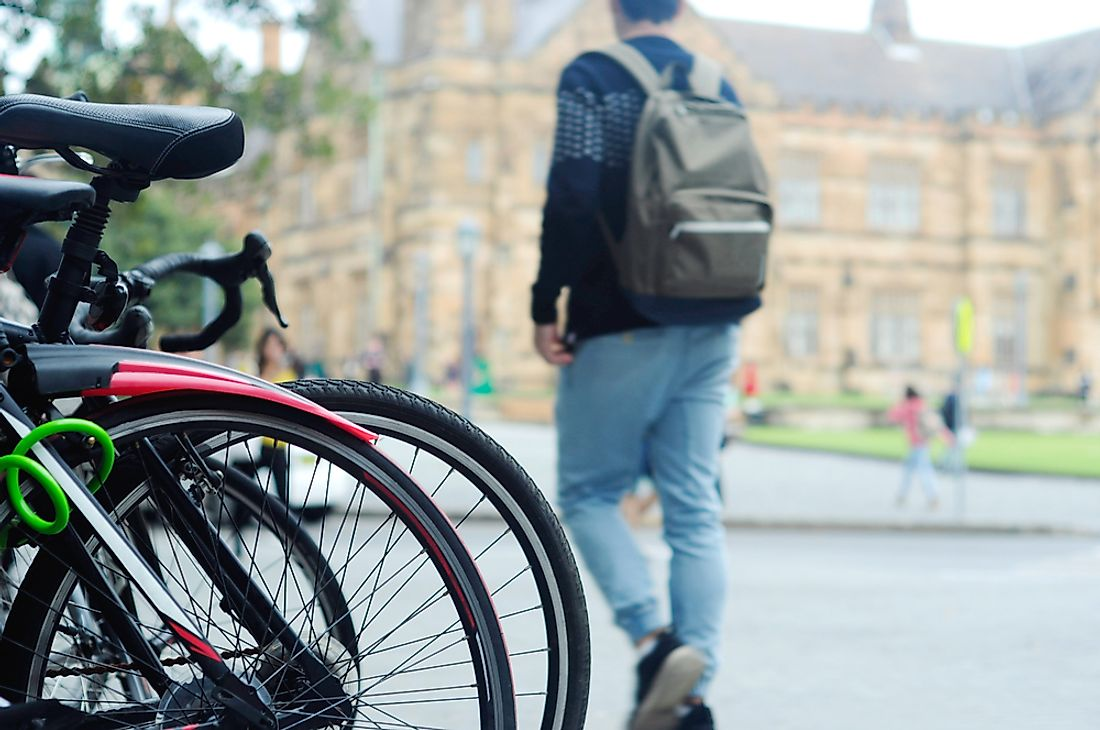 A student walking at the University of Sydney.