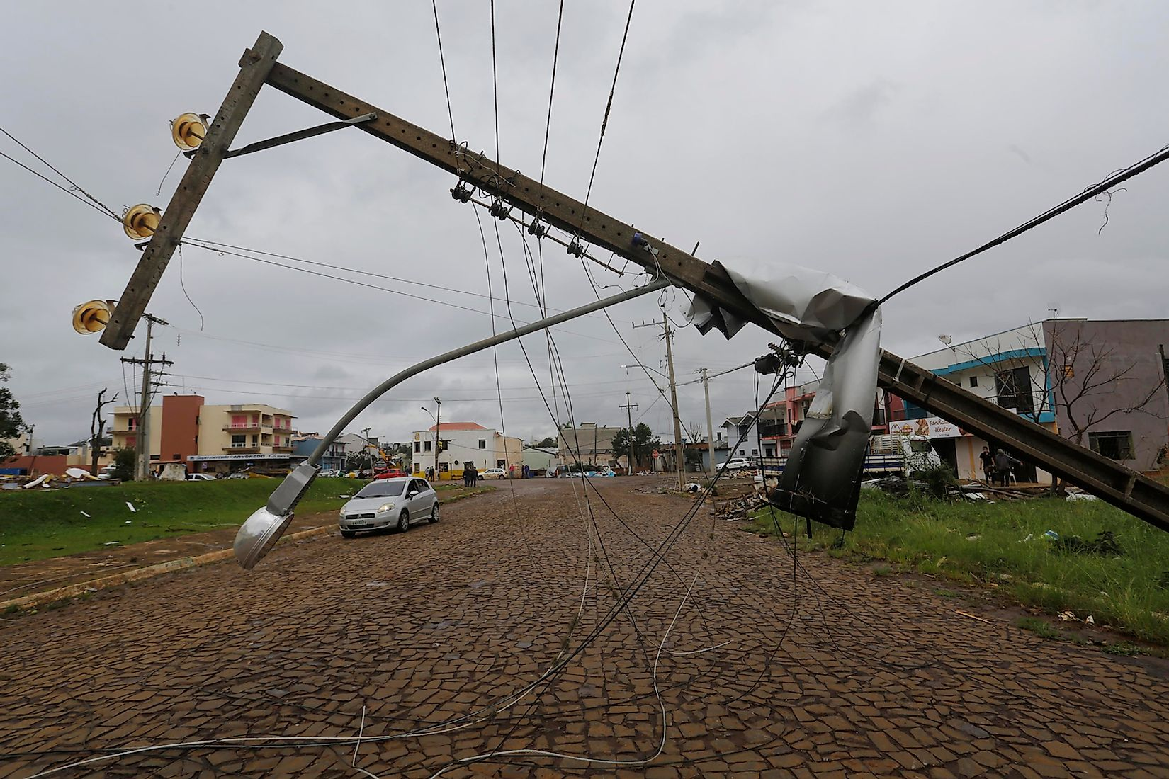 Xanxere, SC / Brazil - April 22, 2015: Power line is down after get destroyed by a tornado in Santa Catarina state killing two people and leaving hundreds homeless. Image credit: Nelson Antoine/Shutterstock.com