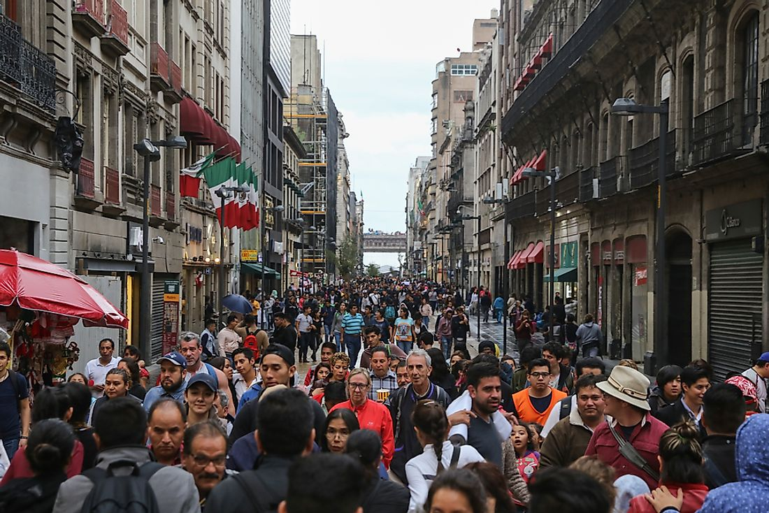 People walk down a busy street in Mexico. Editorial credit: EddieHernandezPhotography / Shutterstock.com.