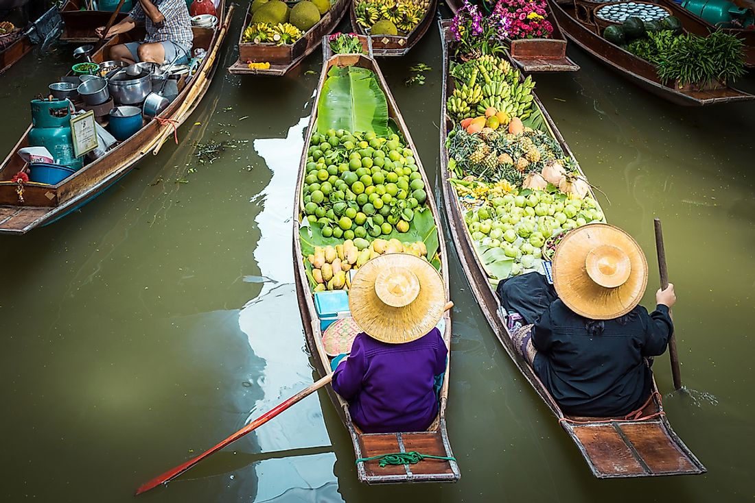 Vendors at a floating marketplace in Thailand.