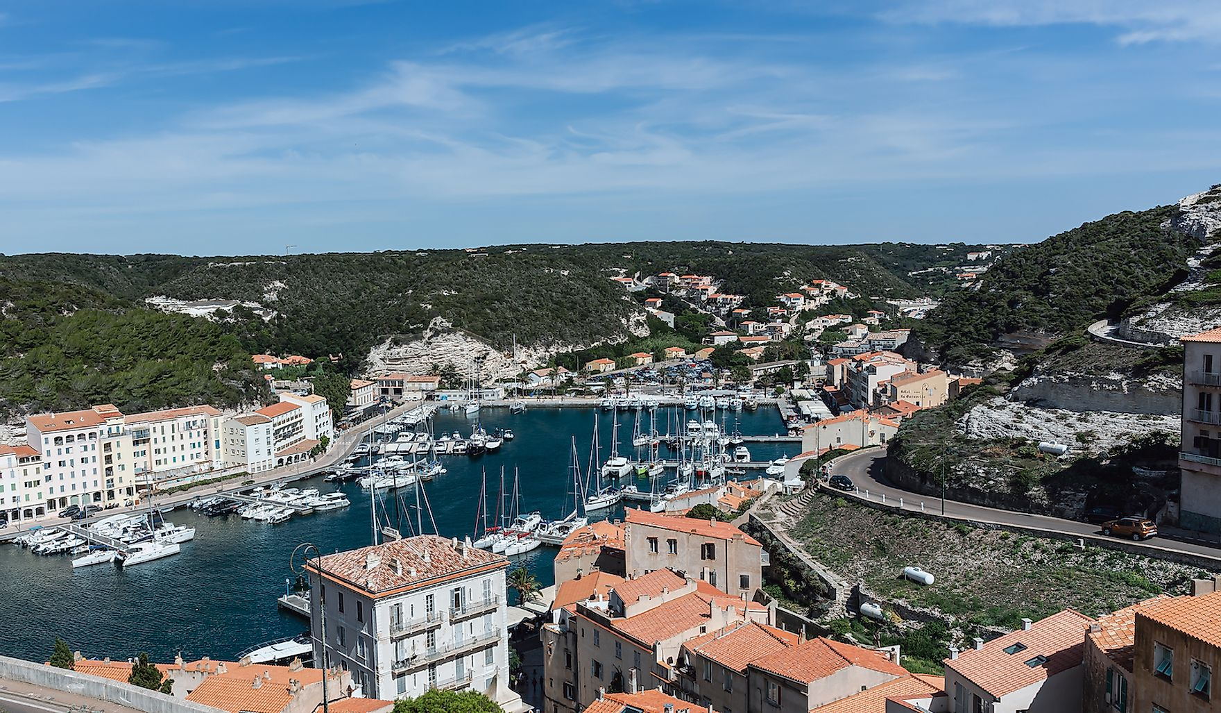 Aerial view of the harbor in Bonifacio, Corsica, an ancient city located directly on the Mediterranean Sea, separated from Sardinia by the Strait of Bonifacio.