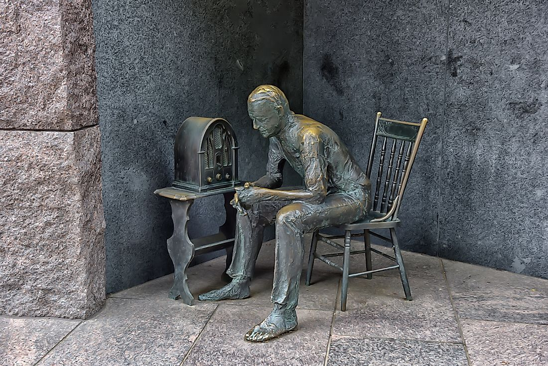 Sculpture at the Franklin Delano Roosevelt Memorial in Washington DC depicting a listener of FDR's fireside chats.  Editorial credit: Evdoha_spb / Shutterstock.com