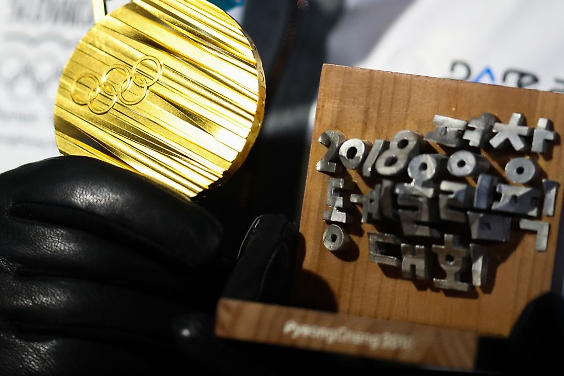 The front of each medal features the Olympic rings. Editorial credit: Andrew Makedonski / Shutterstock.com