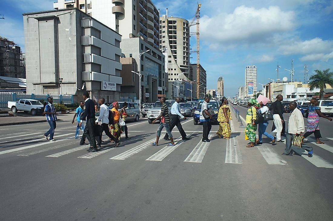 People crossing the street in Kinshasa, Democratic Republic of the Congo. Editorial credit: Alexandra Tyukavina / Shutterstock.com.