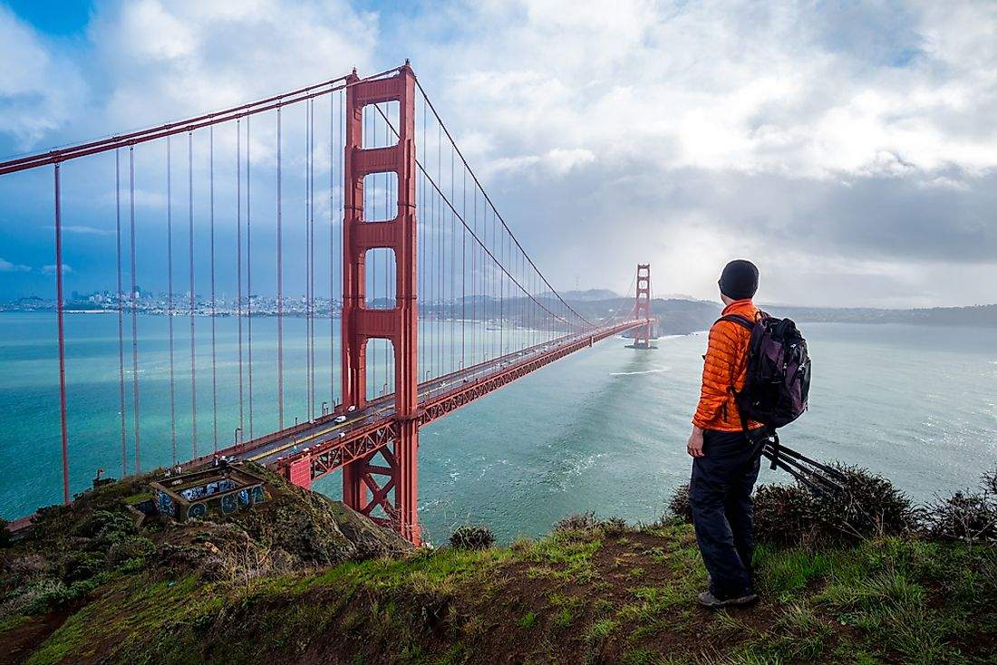 A traveler looking out at the Golden Gate Bridge, California.