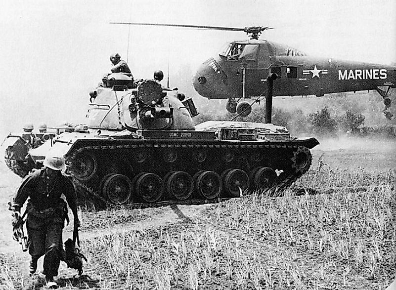 A tank and helicopter removing wounded U.S. Marines from the battlefield and carrying them to military hospital units during the Battle Of Van Tuong.