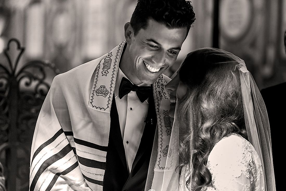 A bride and groom at a traditional Jewish wedding.