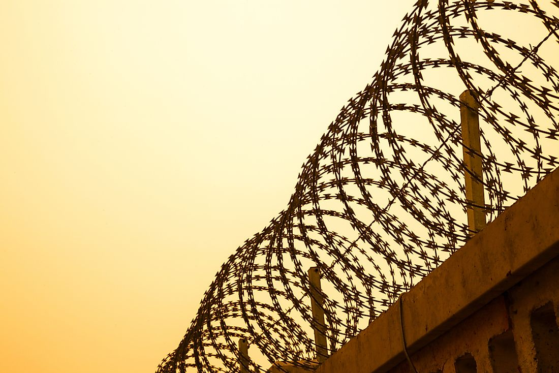 Some borders feature physical human-made barriers such as barbed wire fences.