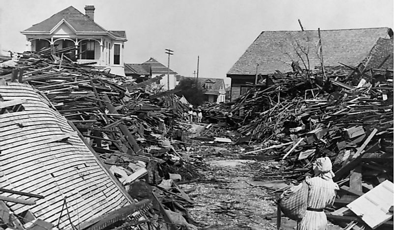 A woman examines the debris left behind in the destructive Galveston Hurricane of 1900. Editorial credit: Everett Historical / Shutterstock.com.