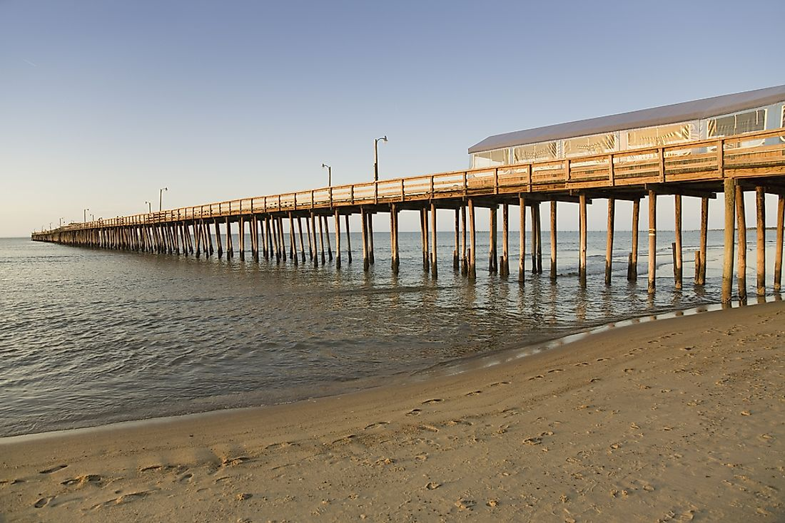 The Virginia Beach Pier extends from the shoreline out into and over the Atlantic Ocean.