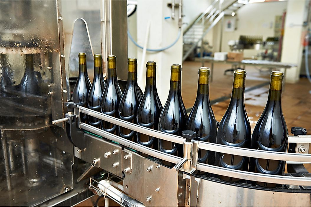 The bottling and sealing process at a winery.