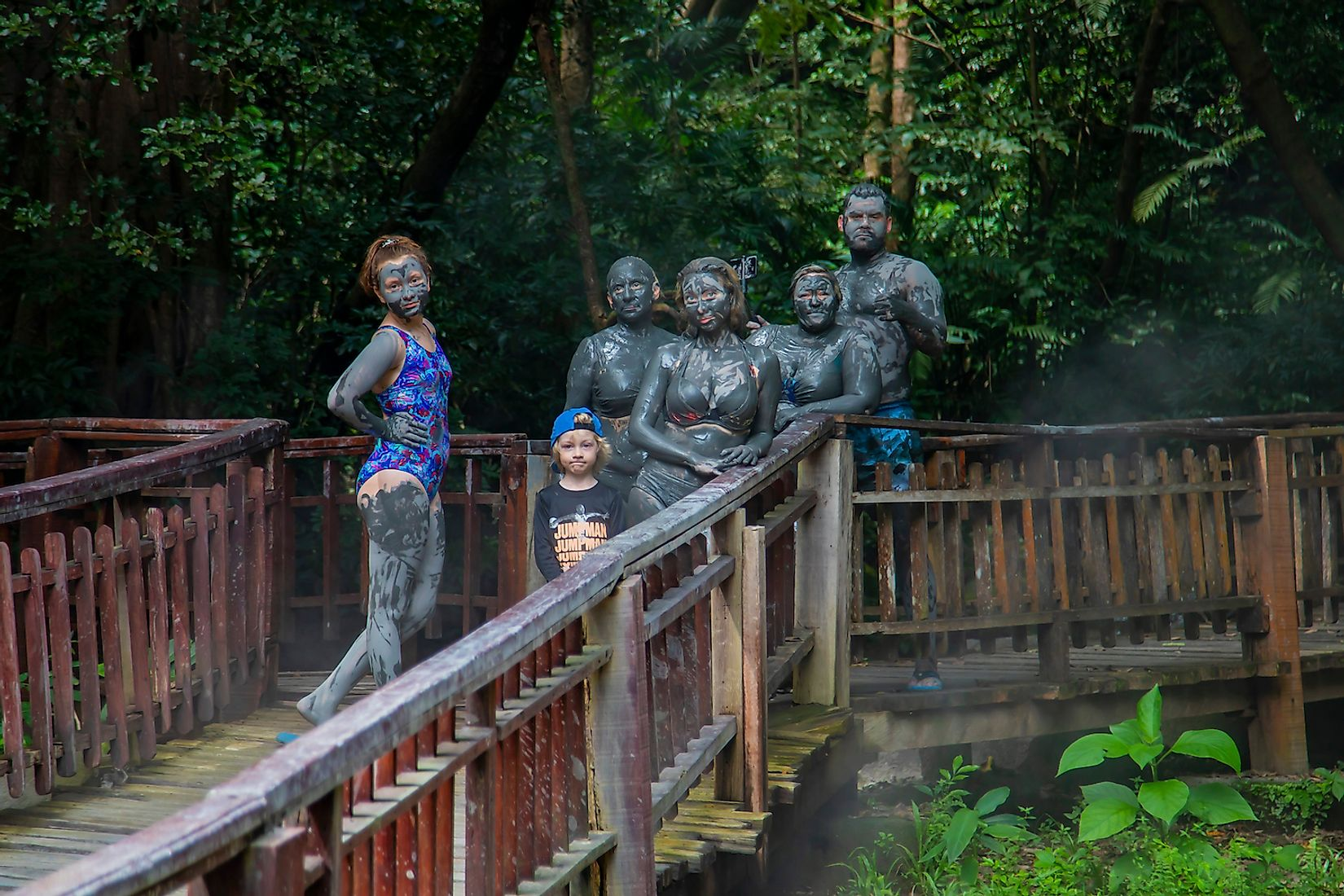 Tourists vacationing in the hot springs on Mount Borinken Costa Rica. Image credit: Xenia_Photography/Shutterstock.com