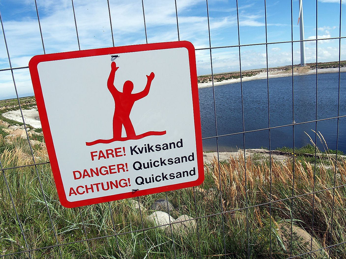 Warning sign for quicksand in Frederikshavn in Denmark. Image credit: Matthew Bargo/Wikimedia.org