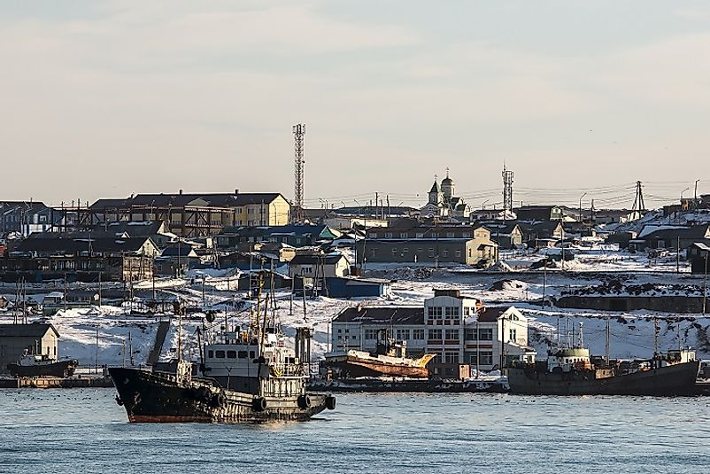 Busy fishing harbors, such as this one near Yuzhno-Kurilsk, Russia, serve as an economic lifeblood for the Kuril Islands' economy.
