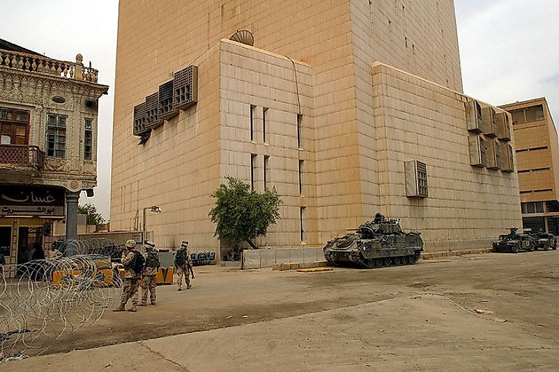 U.S. Soldiers guarding the Central Bank of Iraq shortly after it experienced the most valuable bank heist in world history.