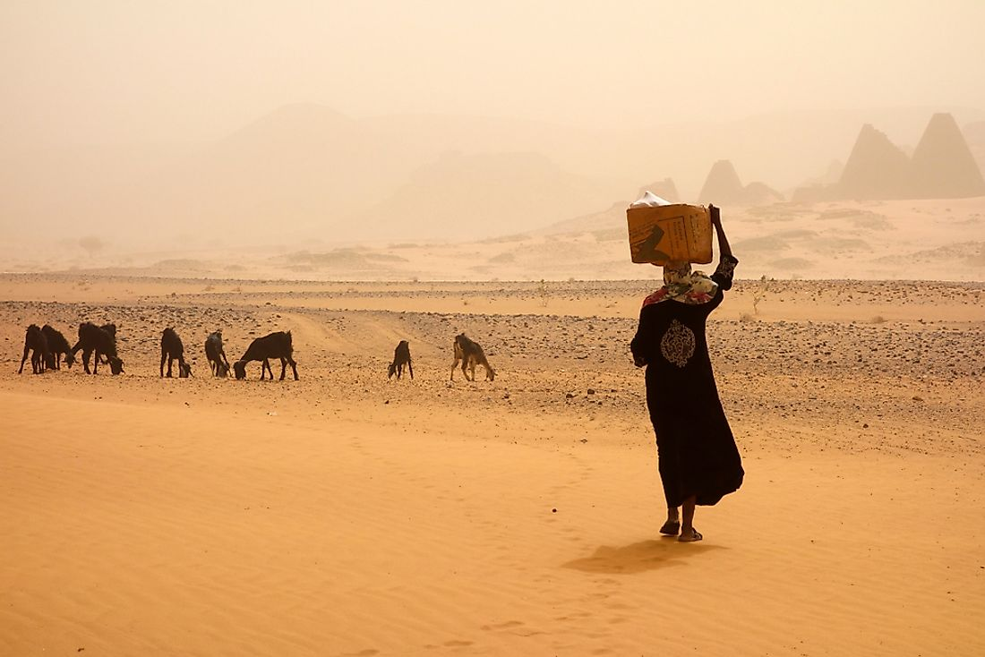 A woman walks during a sandstorm in Sudan.