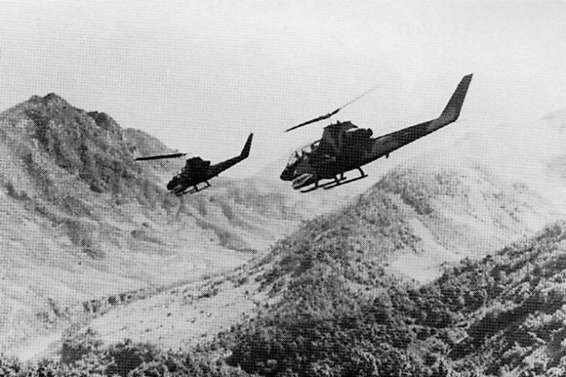 U.S. Army AH-1 Cobra helicopters preparing to attack North Vietnamese forces in Laos.