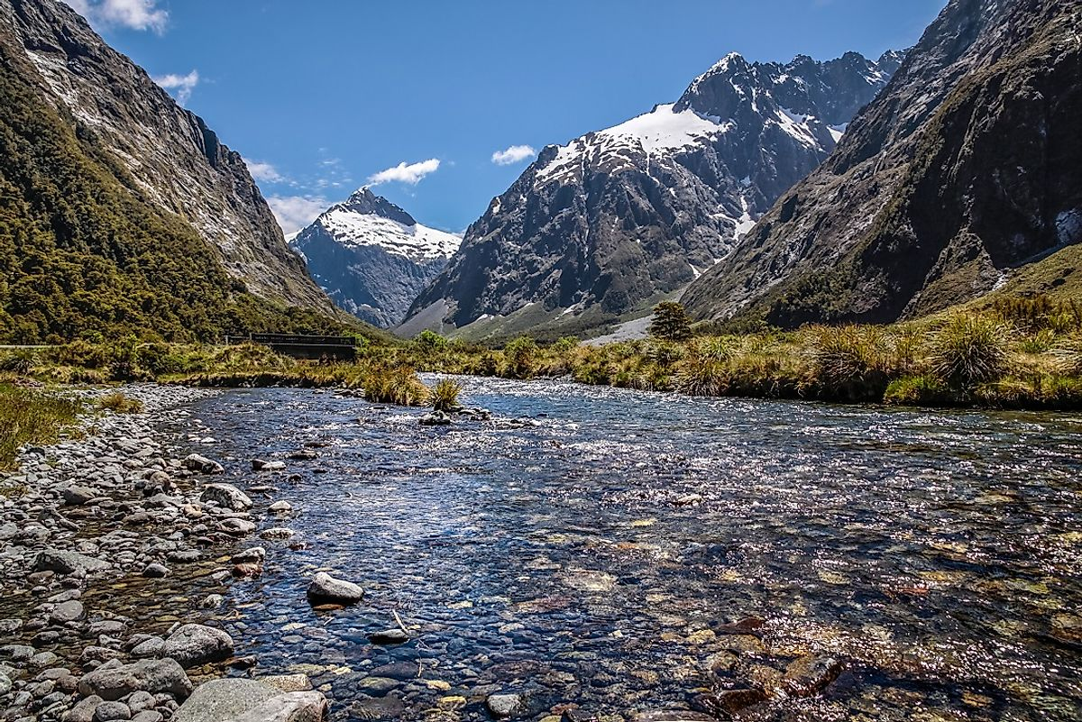 A quiet stream courses through the New Zealand Southern Alps area in Fiordland National Park, near the Milford Road.