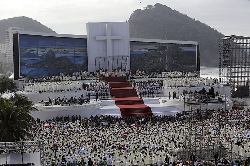Rio de Janeiro, Brazil's Catholic denizens crowd Copacabana Beach as Pope Francis leads them in Mass.