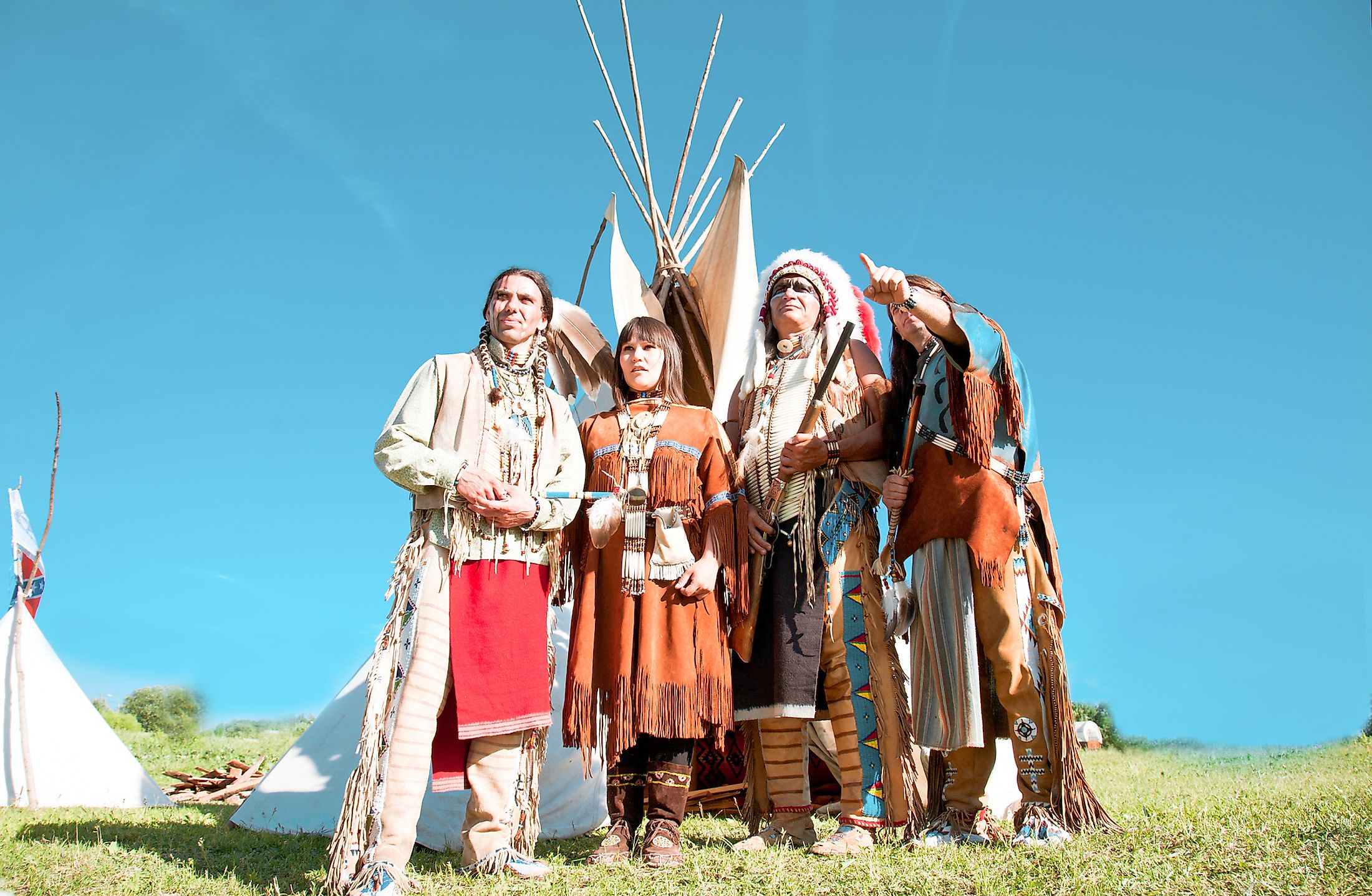 Group of North American Indians about a wigwam. Image credit: Shchipkova Elena/Shutterstock.com